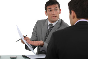 businessmen exchanging views during meeting